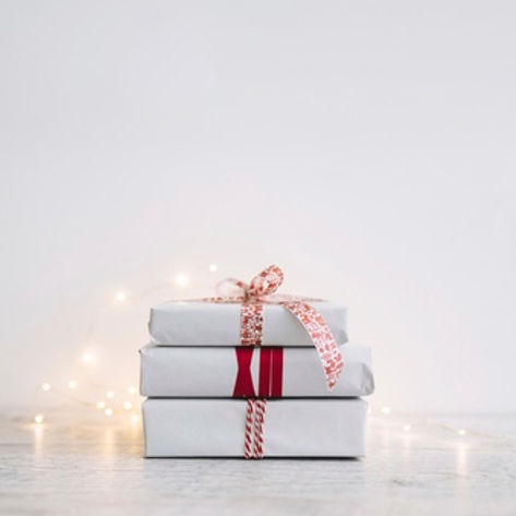 pile-of-white-gift-boxes-with-garland-on