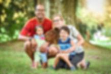 Happy interracial family is enjoying a d