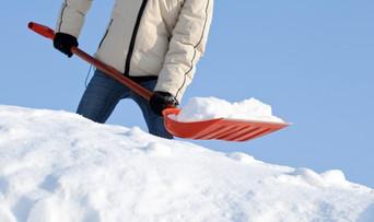 man scooping snow
