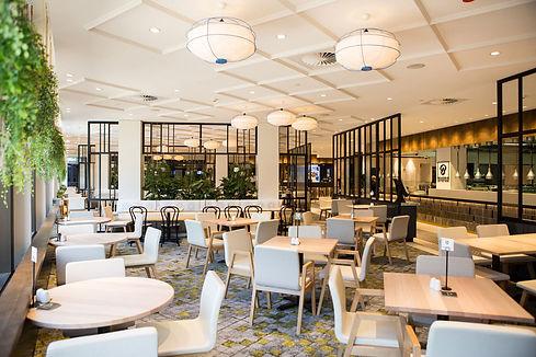 cabravale-diggers-bistro-01-design-restaurant-green-open-furniture-carpet.jpg