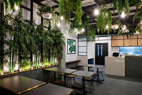 madam-chai-05-restaurant-design-green-plants-brick-tiles-lights-timber-decor-food-artwork.