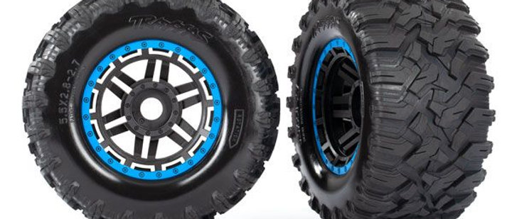 TRA8972A Traxxas Tires & wheels, assembled, glued (black, blue beadlock