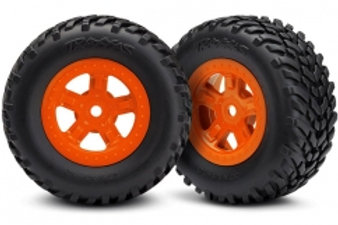 Traxxas Tires and wheels, assembled, glued (SCT orange wheels,