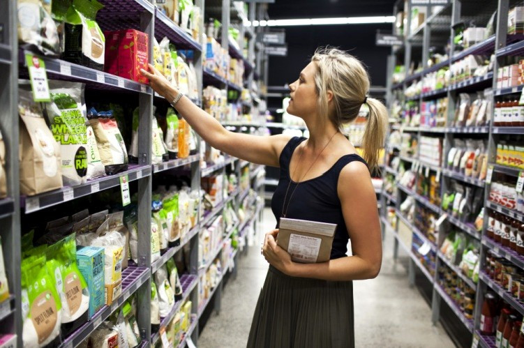 Sydney based nutritionist Skye Swaney grocery shopping in her local supermarket