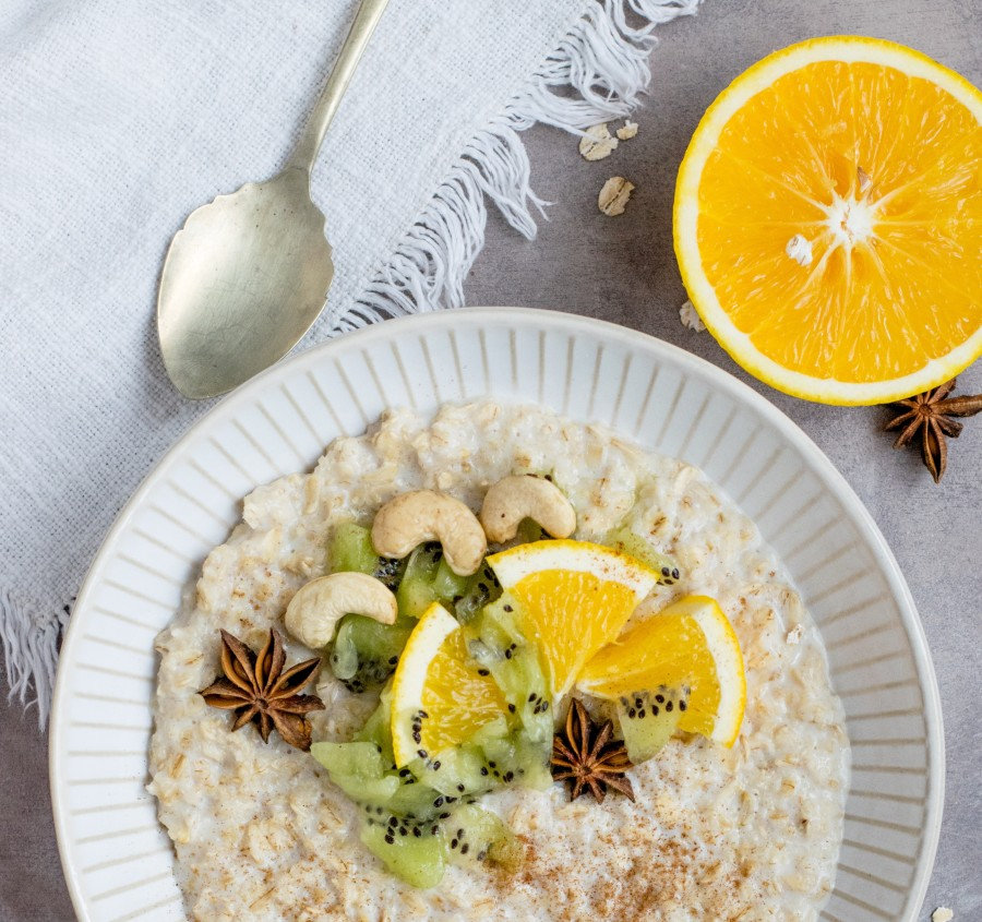 Oats for breakfast, Oats with kiwi, cashew and orange. Made with milk powder