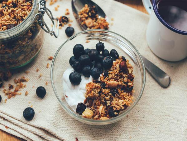 Greek Style Yoghurt made with milk powder. Recipe using granola yoghurt and berries