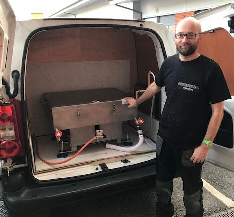 photo of Gareth with dip tank in the back of our van