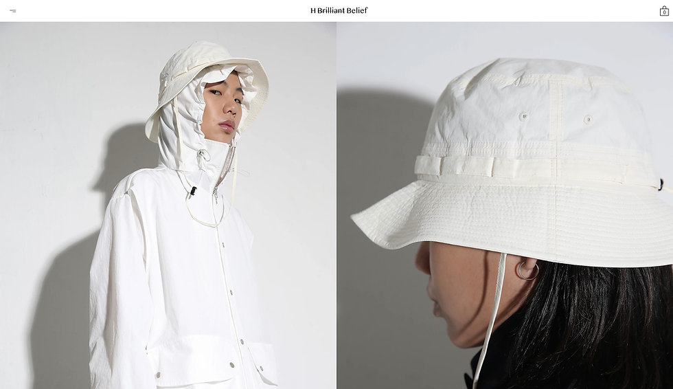 Website thumbnail for HGBB Studio. Image shows, white horizontal menu at the top with black text in the center. Beneath that there are 2 images filling the entire space side by side. The left image shows a person facing to the right looking at the camera, they are wearing white clothing, a jacket with a hood and a hat on top. On the right, you can see the back of a person also wearing white clothing. Both backgrounds are white as well.