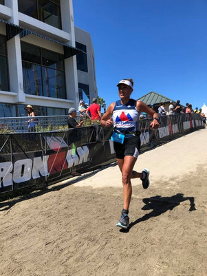 Maria finishing IM Santa Cruz 70.3