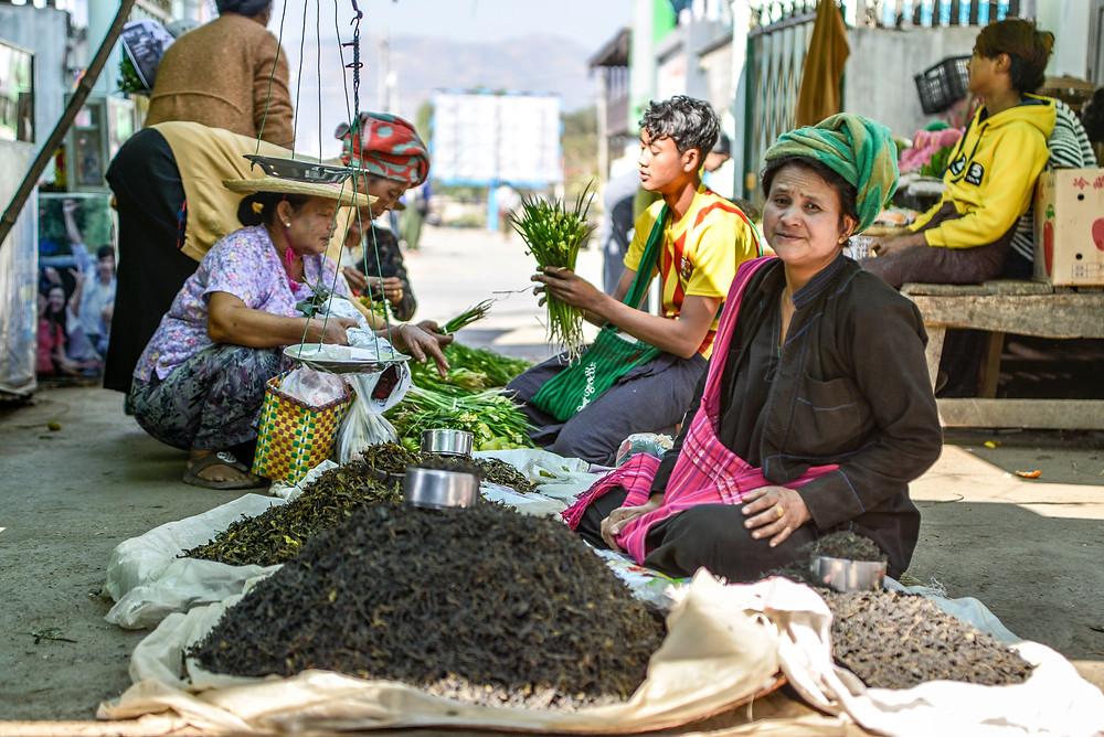 old woman selling herbs on a market in Nyaung Shwe Inle Lake Myanmar