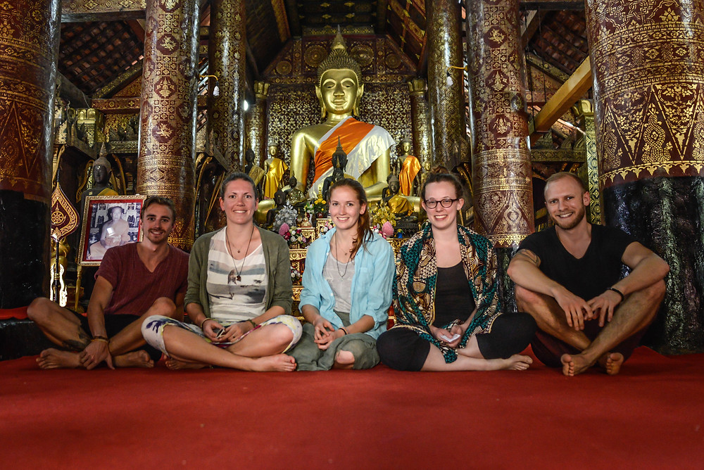 amazing people in a buddhism temple in Luang Prabang