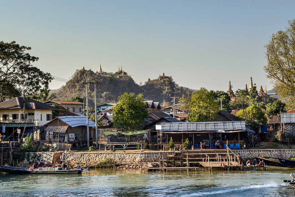 little village at Inle Lake with some mountains in the background. Myanmar