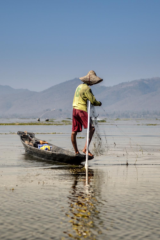real fisher prepares his net at Inle Lake Myanmar