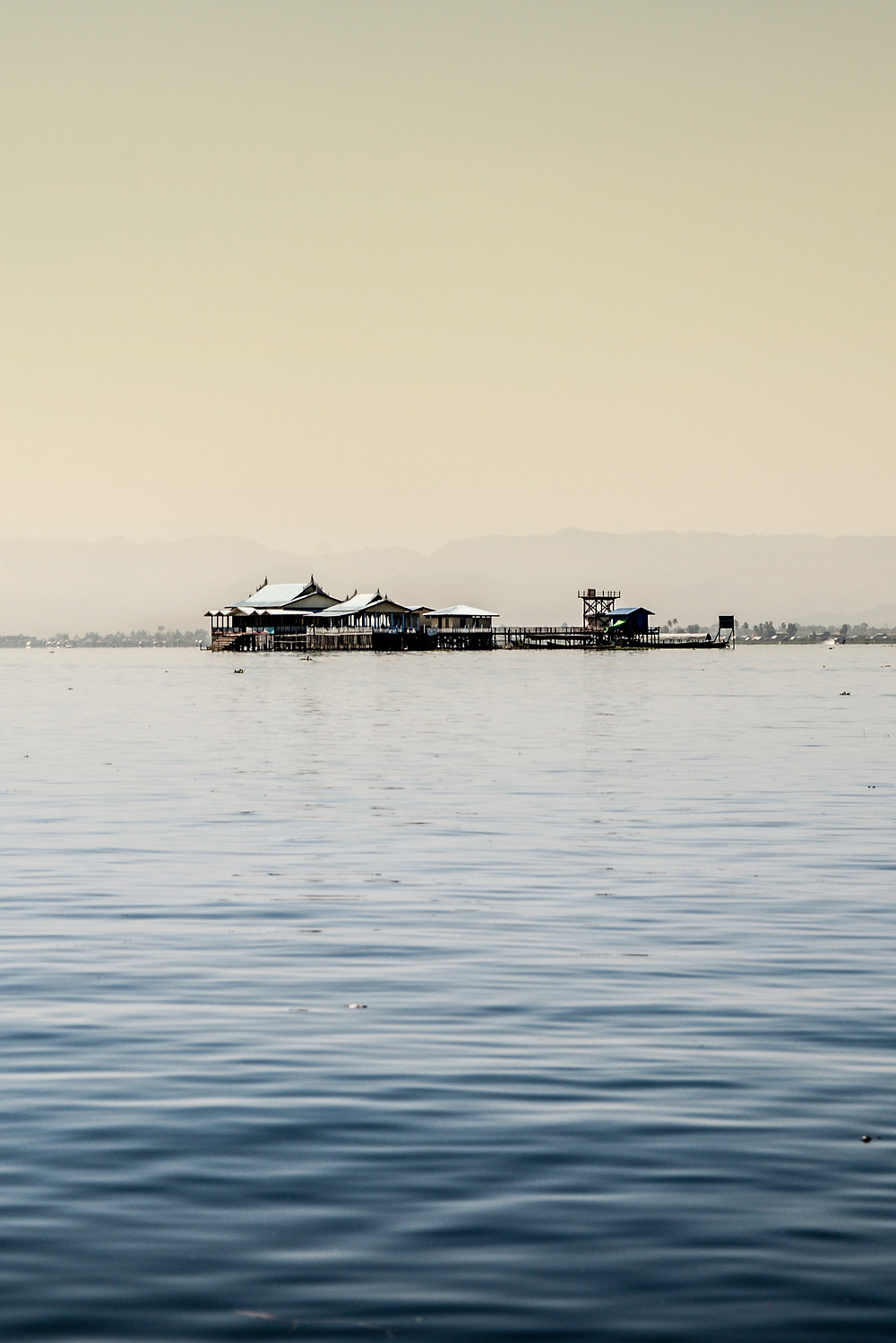 buildings on stilts on the water at Inle Lake Myanmar