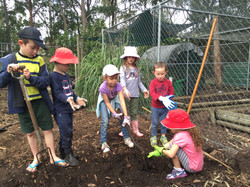 Kids helping out at Working Bee