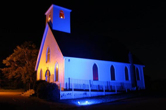 Old Barns UC Lit up for Blue Vigil