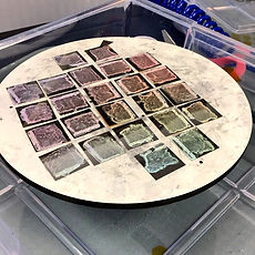 Photo of silver coated glass slides in the cleanroom. Silver shines line a rainbow
