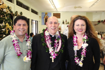 Elena Kareneva, underwriter for Immaculate Heart Catholic Radio in Maui with the Bishop of Honolulu Larry Silva and Joseph Nesta