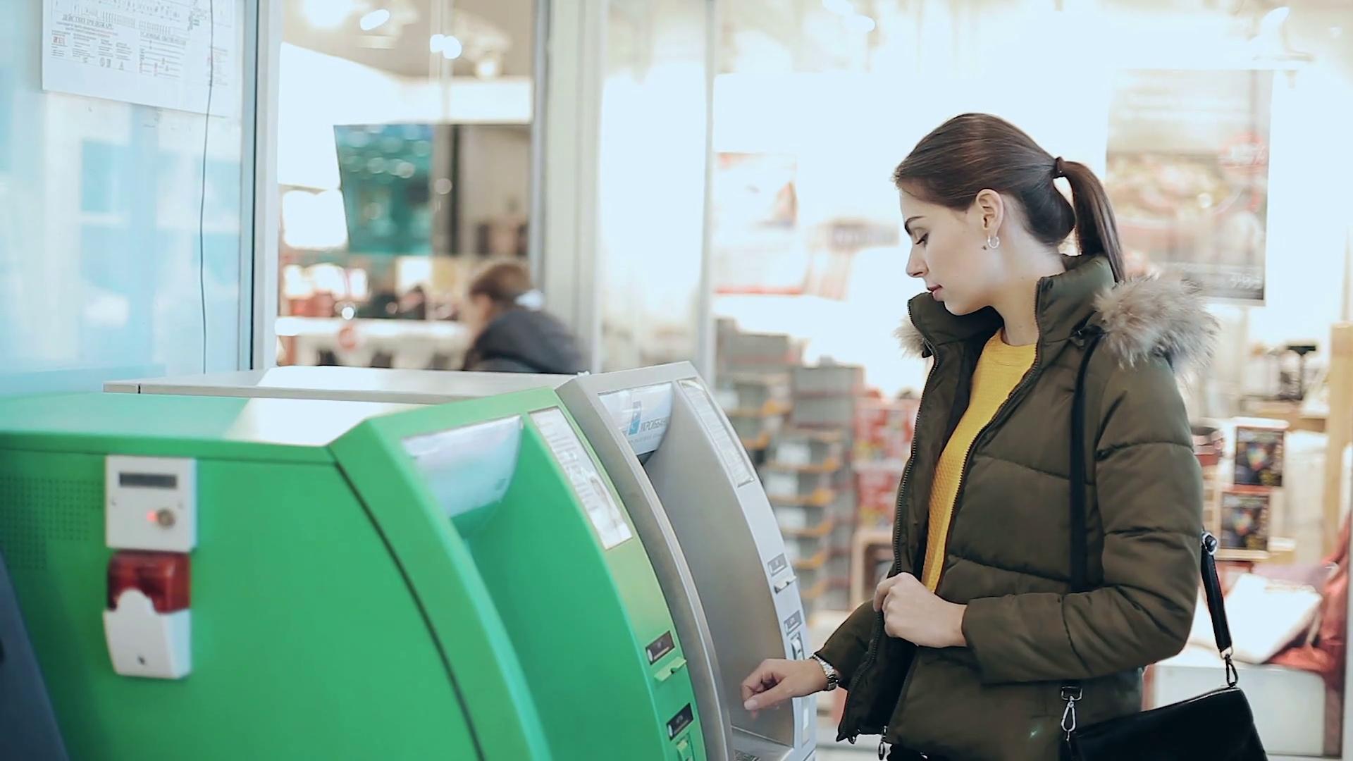 Millennial at ATM