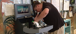 ATM technicin performing standard maintenance