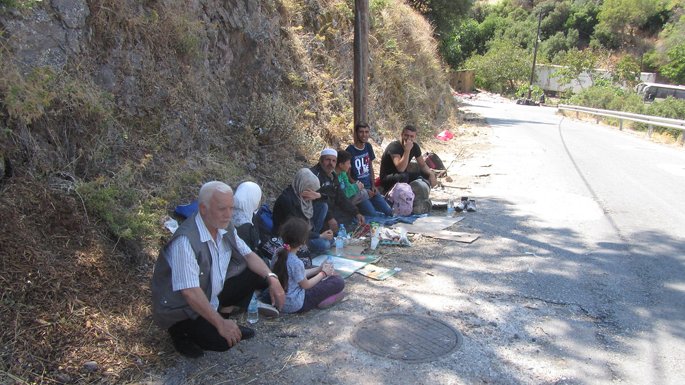 Syrian Family outside of Sikiaminia