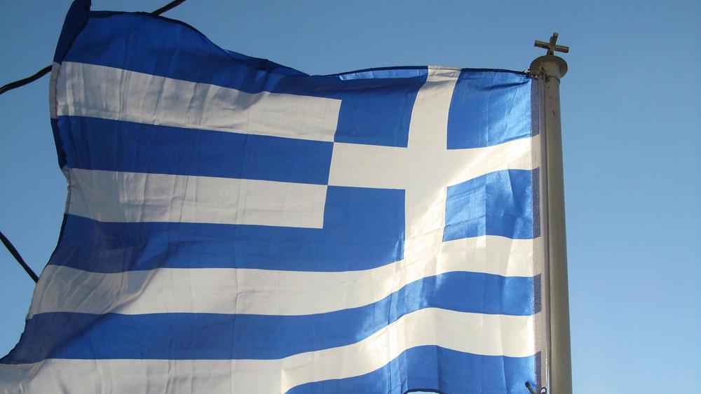 Greek flag flying left photo:  Andrea Sarris