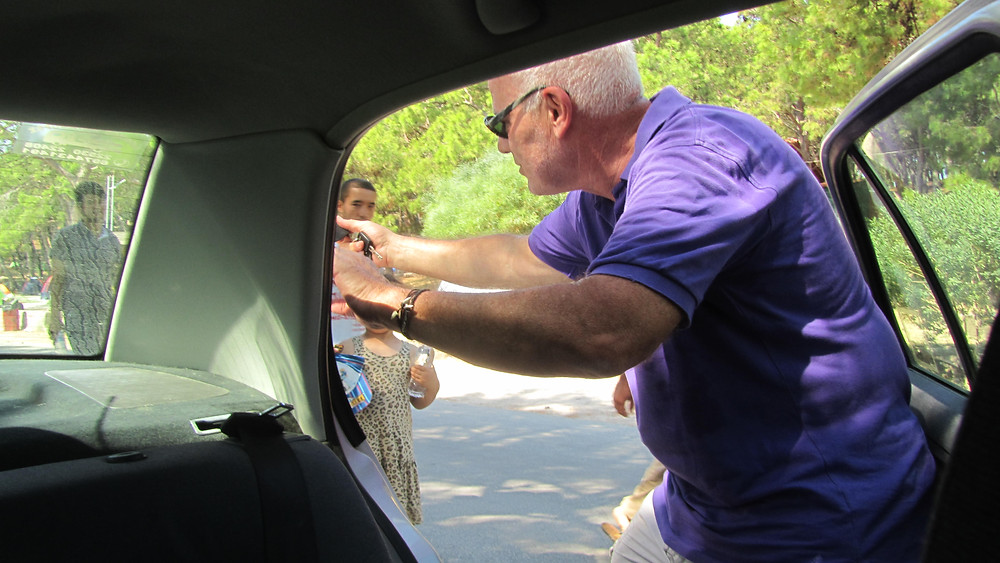 Michael handing out water