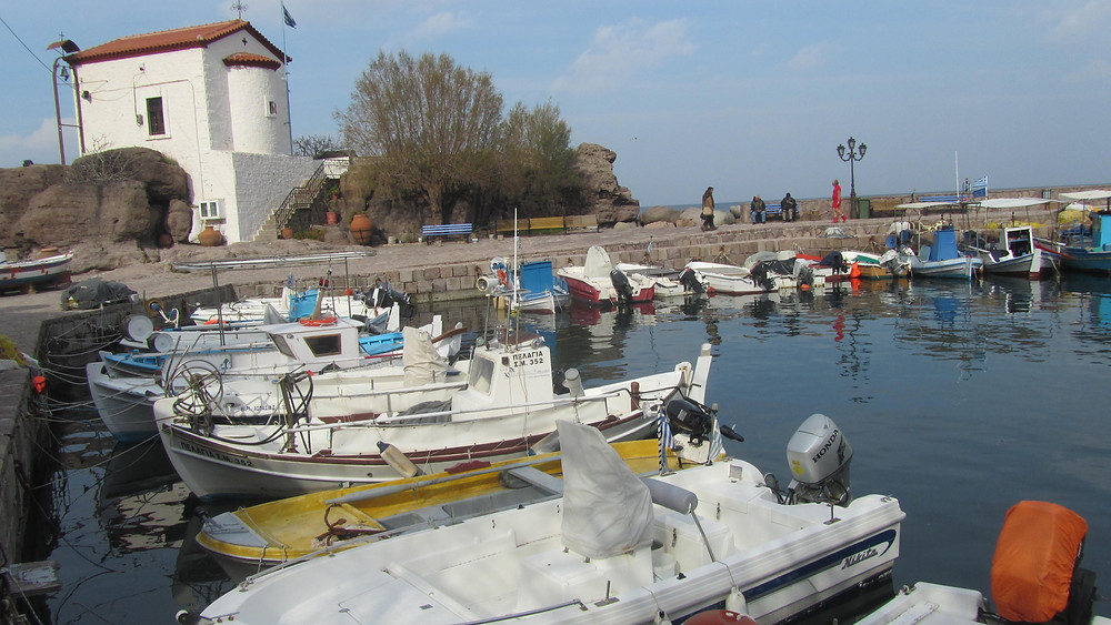 Skala Sykiaminias Harbor with locals in background photo: Andrea Sarris