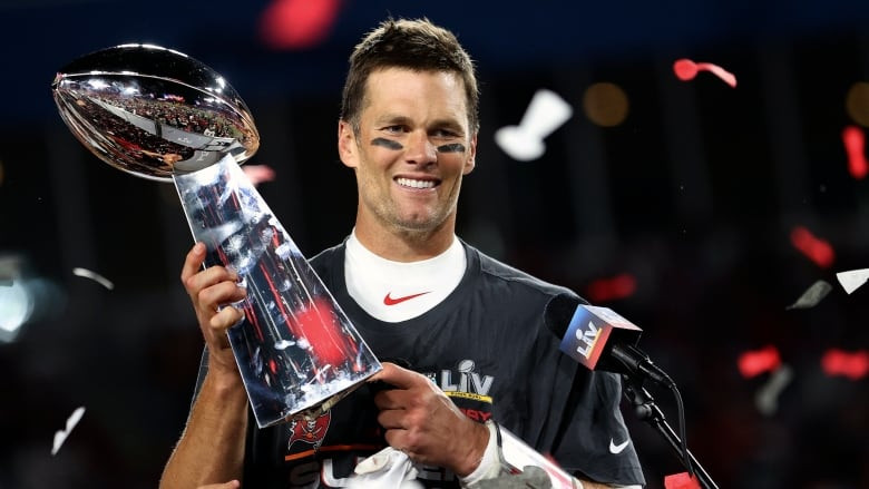 Brady holding seventh Lombardi Trophy