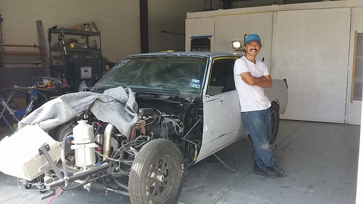 Superior Collision painter Noe taking a