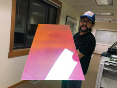 Artist Matt Bajor with a finished sheet of the dichroic acrylic