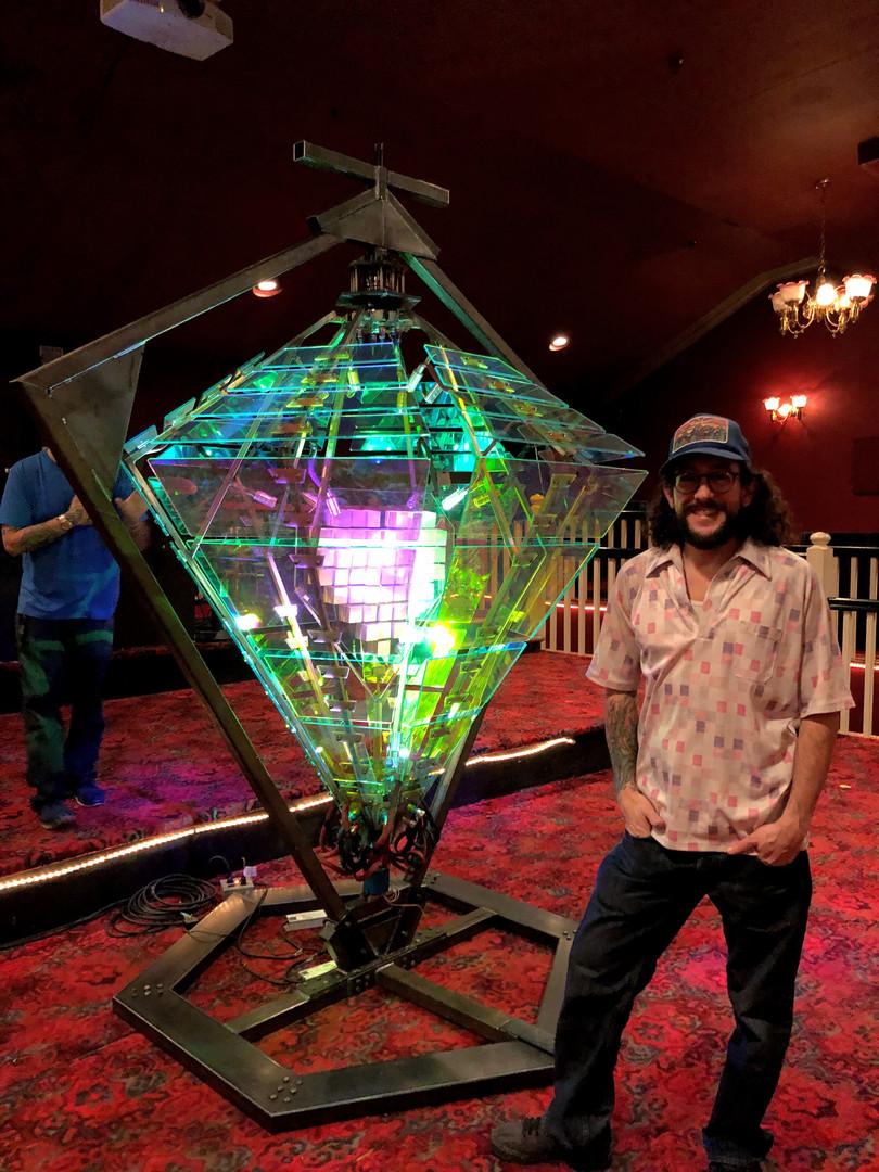 Kinetic Artist Matt Bajor standing next to Double Diamond