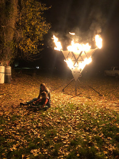 Family playing by the light of Fryangle