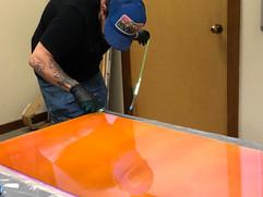 Matt Bajor trimming the edge of the dichroic film for Double Diamond