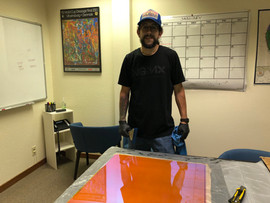 Matt Bajor applying the 3m dichroic film to the acrylic