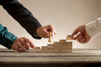 business-teamwork-concept-with-businessman-moving-chess-piece-up-series-steps.jpg