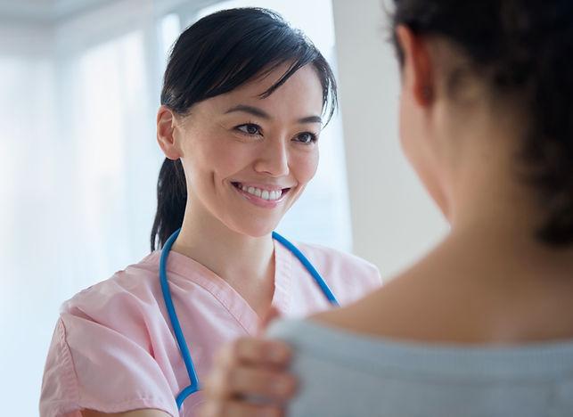Nurse%20Talking%20to%20Patient_edited.jp
