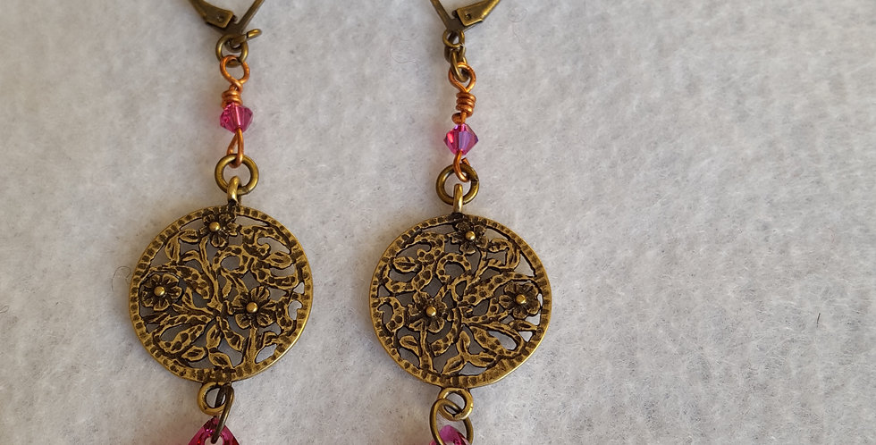 Etched brass round with flower design w/ruby color Swarovski crystal teardrop