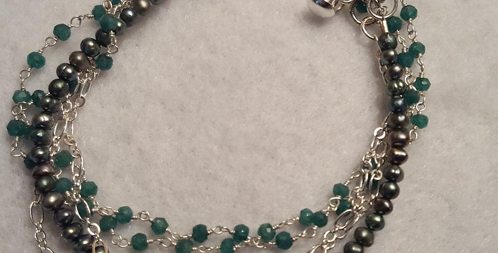 Quadruple strand bracelet