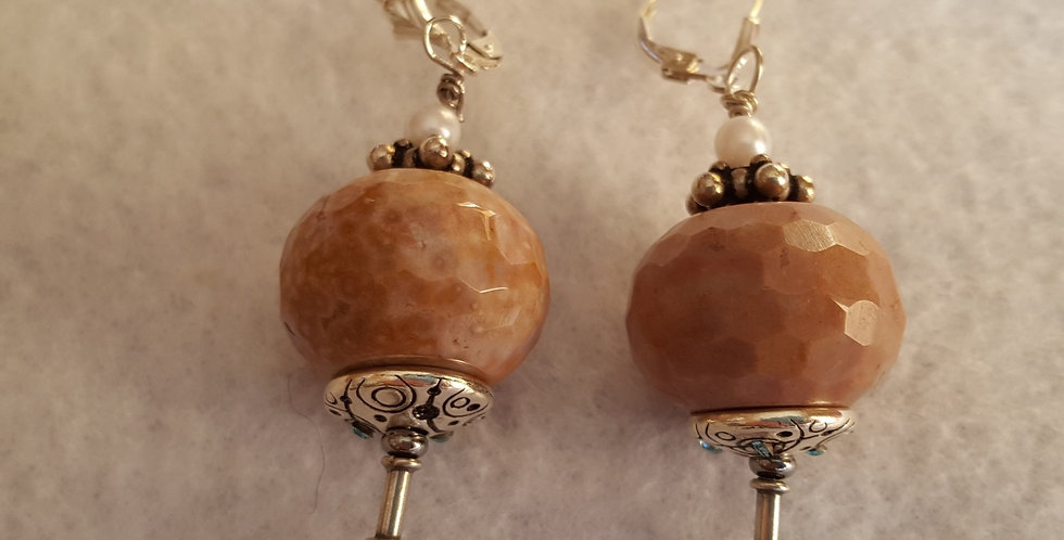 Pink-tan faceted agate on fancy eye pin and sterling silver Bali cap.