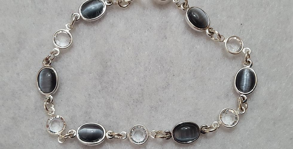 - Sterling silver bracelet with pretty blue-gray cat's eye bracelet