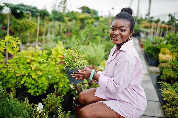 african-woman-pink-large-shirt-posed-gar