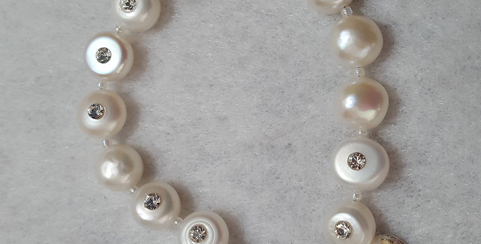 Cultured flat, round pearls with a rhinestone embedded in each pearl bracelet