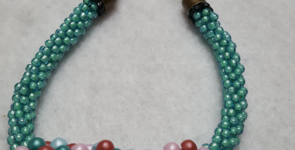 Braided bracelet with frosted silver & blue lined green TOHO seed beads