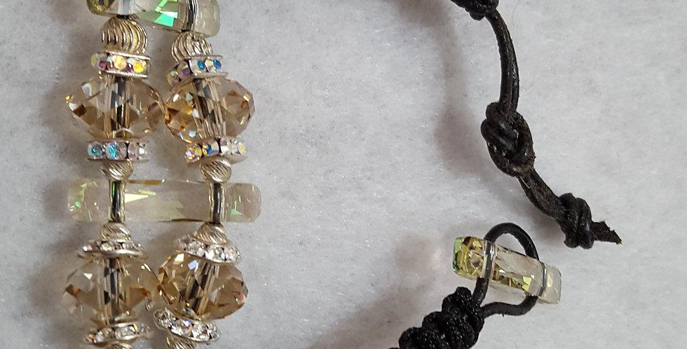 Macramé nylon over black leather strand bracelet