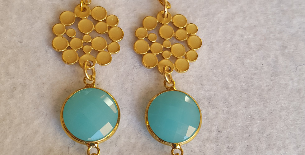 Gold honeycomb earrings has a light turquoise stone w/gold bezel