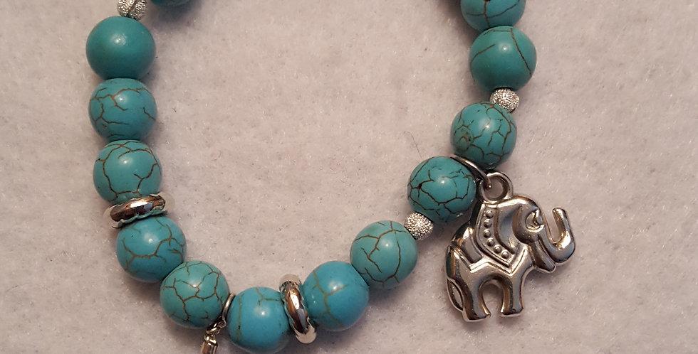 Stabilized turquoise, sterling silver elephant charm bracelet