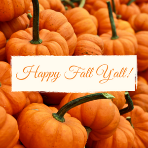 Happy Fall Y'all sign with a pumpkin patch in the background.