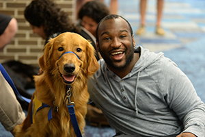 dog with man in UNF library