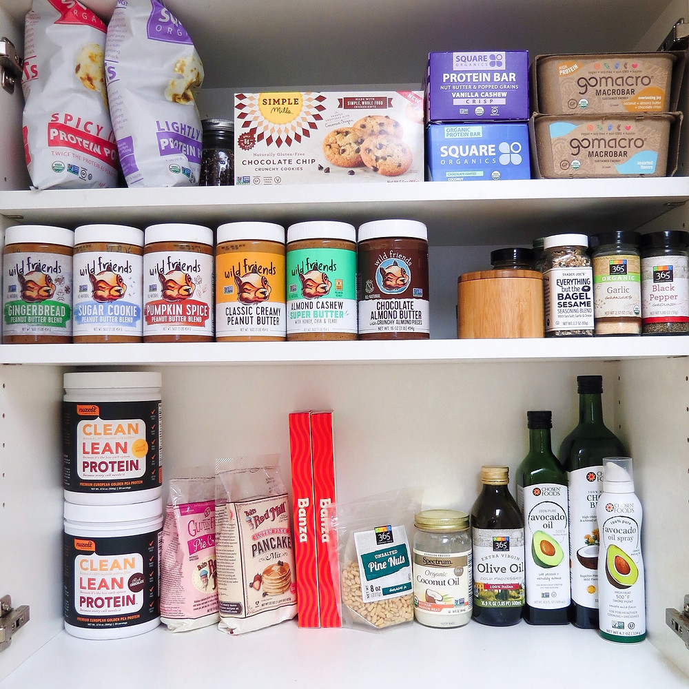 A picture of pantry items like popcorn, peanut butters, seasonings, oils, and protein bars.